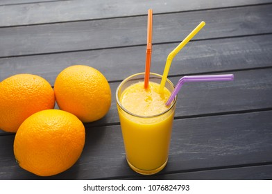 Organic Oranges and juice with straws