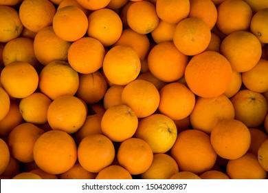 Organic oranges at the market  closeup background.