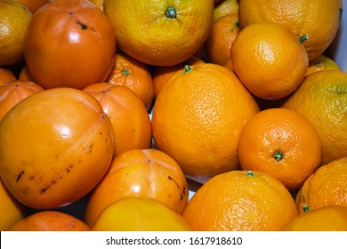 Organic oranges, tangerines and persimmons