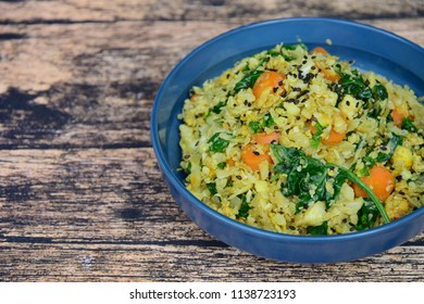 Organic Paleo Cauliflower Fried Rice with vegetables, Herbs and Spices. On wooden background