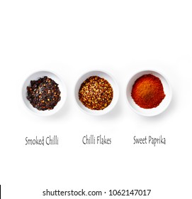 Organic Paprika Powder, Chilli Flakes and Smoked Chilli Flakes on White Background. Natural spices