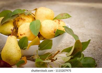 Organic pear, healthy food - organic pears in white bowl closeup