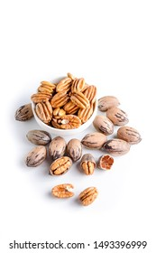 Organic pecan nuts on a white background, shelled and unshelled, with space for text
