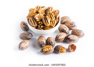 Organic pecan nuts on a white background,shelled and unshelled.