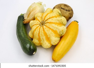 Organic Potato, Courgette, Onion. Farm Vegetables. Patty Pan Vegetable Marrow Isolated on White Background. Ugly Organic Agriculture for veg Harvest. Green and Yellow Zucchini with Potatoes