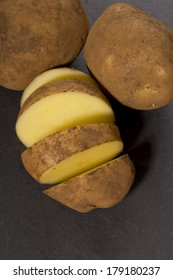 Organic potatoes on slate