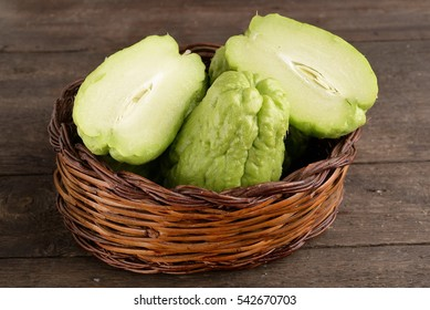 Organic prickly pumpkin on the table - Chayote (chayote)