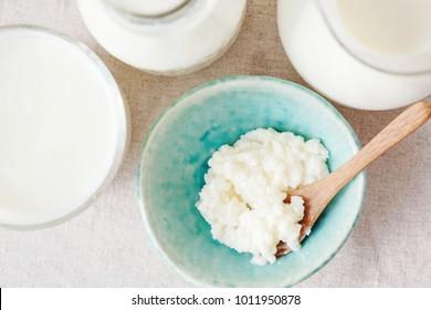 Organic probiotic milk kefir grains, Tibetan mushrooms and kefir milk in glass containers