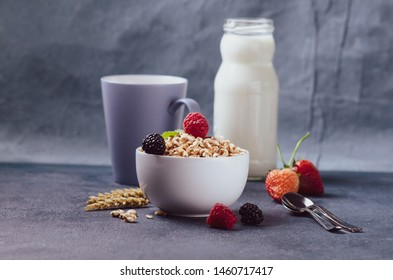 Organic puffed spelt wheat in blue bowl with milk and strawberry for breakfast.