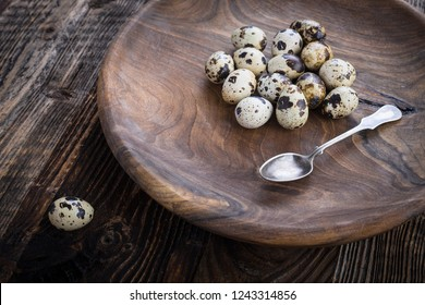 Organic quail eggs on the wooden plate. Natural gourmet meal.
