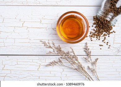 Organic raw bee pollen and honey on white wooden background with copy space, flat lay