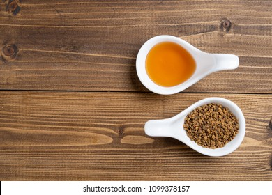 Organic raw bee pollen and honey on wooden background with copy space, flat lay