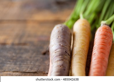 Organic Raw Carrots Close Up On Vintage Rustic Wood Texture Table Background. Selective Focus. Defocused. Copy Space.
