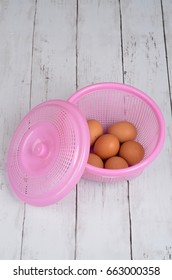 Organic and raw eggs in the basket