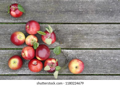 Organic red apples on the old table