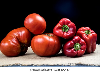 organic red tomatoes and red peppers bell