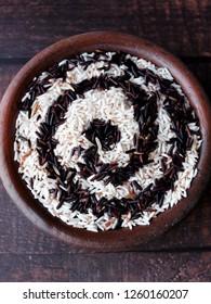 organic rice in an earthen bowl