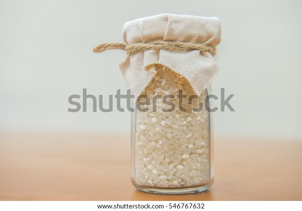 the organic rice in glass bottle
