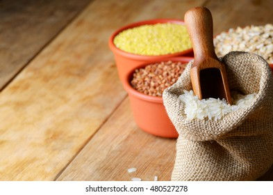 Organic rice grains in burlap sack with copy-space