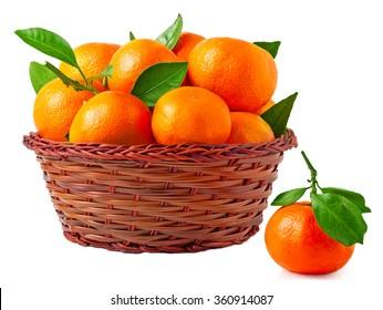 organic ripe mandarins in basket on white background