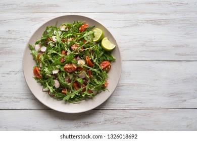 Organic salad with arugula and quinoa.