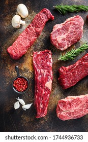 Organic set of raw alternative beef steaks flap flank Steak, machete steak or skirt cut, Top blade or flat iron beef and tri tip, triangle roast with denver cut side view over old rustic metal surface