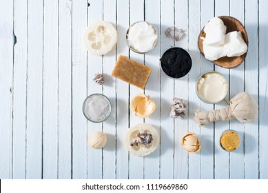 organic skin care butters from, shea, macadamia nut, coffee, mango, and cosmetic clay, mud on white wooden