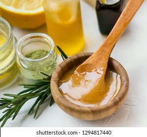 Organic skincare ingredients with manuka honey, oils, clay and rosemary herb, spa still life products honey closeup