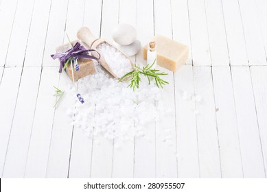 organic soap with lavender flower and bath salt on white wood table