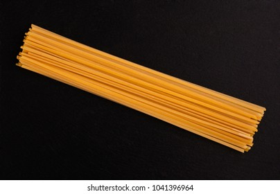 Organic spaghetti on black slate base. Fine Italian food. Professional Studio Image