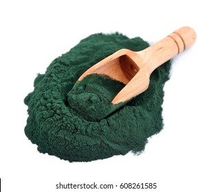 Organic spirulina algae powder in a wooden spoon isolated on white.