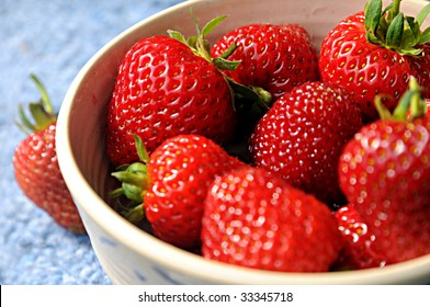 Organic strawberries in rustic bowl