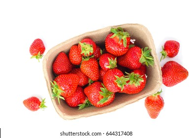 Organic strawberry in paper box on white background