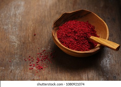 Organic sumac spice in bowl, food closeup