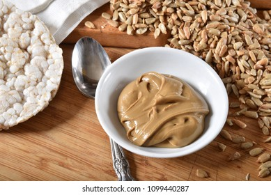 Organic sunflower seed butter with rice cakes in a bowl