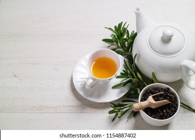 Organic tea on the white stone background with a space for text.
