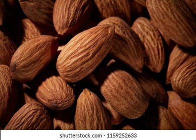 Organic texture of almonds. View from above. Almond. Almonds macro. Almonds background. Almond nuts.