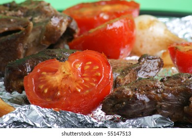 organic tomato and onion on a grill