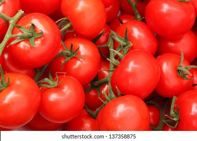 Organic tomatoes in a pile, bio market concept, food background