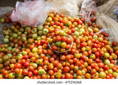Organic tomatoes for sale on street market in Laocai, Vietnam.