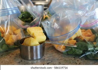 Organic vegan make ahead smoothie bag ingredients; organic spinach, organic mango and organic pineapple