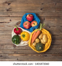 Organic vegetables and fruits in reusable cotton bags from farmer's market, eco-friendly lifestyle and shopping, zero waste, plasticfree packing