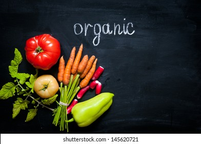 organic vegetables on a black background