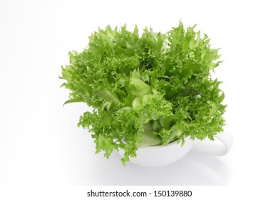 Organic vegetables in white glass on white background.