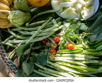 Organic vegetable,various Homegrown vegetable On the banana leaf The sun is shining down to look beautiful Tomato, mung bean, cucumber, wild cucumber, Banana Non-toxic eat healthy and safe.