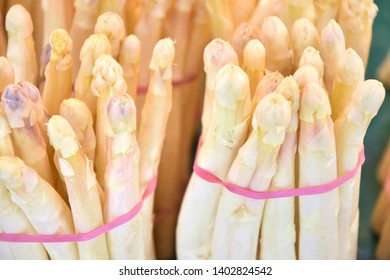 Organic white asparagus with selective focus. New eco harvest, white asparagus. Bunch of fresh ripe asparagus. Asparagus on the market stall. Dietary low-calorie vegetable. Seasonal vegetables