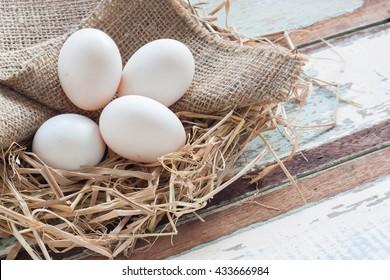 Organic White Eggs On Vintage Wooden Background.