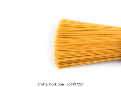 Organic whole wheat spaghetti pasta on white background