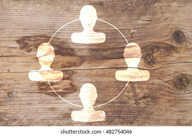 Organigram with heads on wooden background