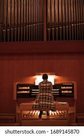 Organist playing a pipe organ
